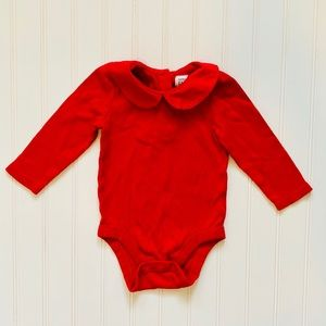 Long sleeved red onesie
